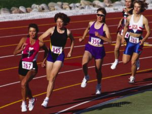 Female runners competing on track