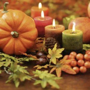 Thanksgiving 2020 pumpkin, lit candles, maple leafs